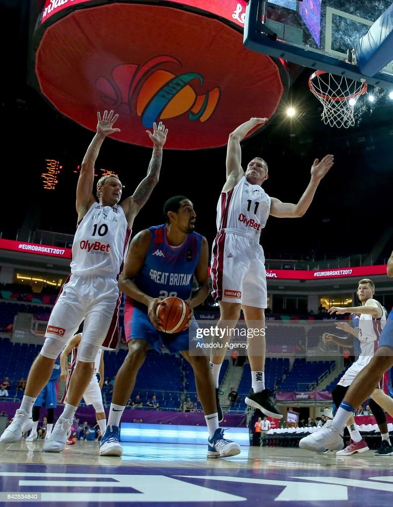 Kieron Achara (21) of Great Britain vies with Rolands Smits (11) and Janis Timma (10) of Latvia during the FIBA Eurobasket 2017 Group D Men's basketball match between Latvia and Great Britain at Ulker Sports Arena in Istanbul, Turkey on September 4, 2017.