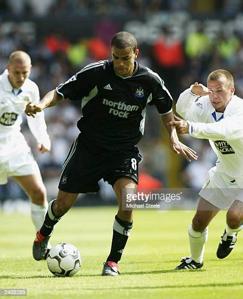 Kieron Dyer of Newcastle holds off Jody Morris of Leeds during the FA Barclaycard Premiership match between Leeds United and Newcastle United on...