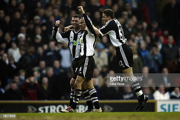 Kieron Dyer of Newcastle United celebrates scoring his second goal with teammates Gary Speed and Laurent Robert during the FA Barclaycard Premiership...