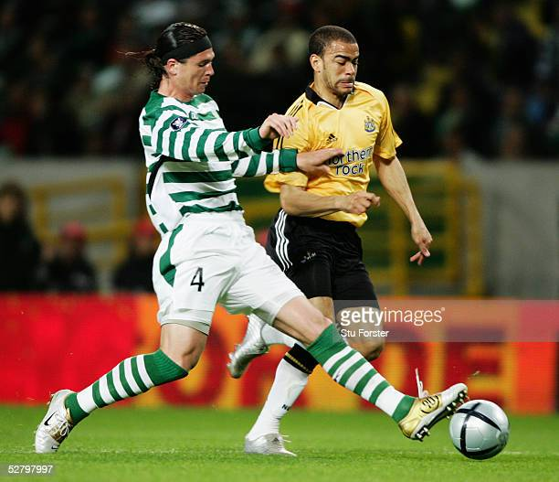Kieron Dyer of Newcastle United takes on Anderson Polga of Sporting Lisbon during the UEFA Cup Quarter Final second leg match between Sporting Lisbon...