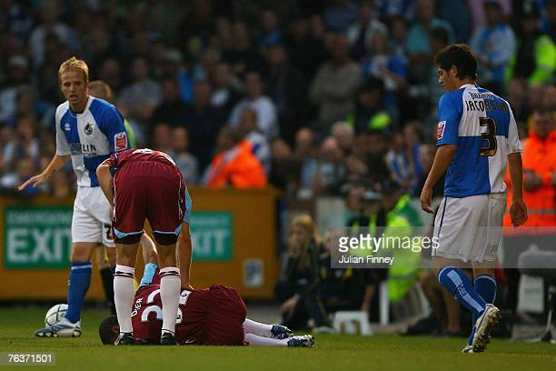Kieron Dyer of West Ham goes down injured after a tackle from Joe Jacobson of Bristol Rovers during the Carling Cup match between Bristol Rovers and...