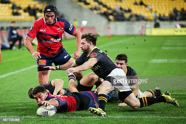 Kieron Fonotia of Tasman scores a try past the defence of Jonny Bentley of Wellington during the round five ITM Cup match between Wellington and...