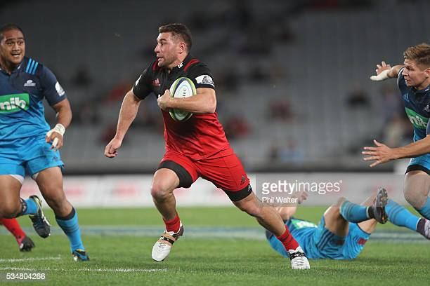 Kieron Fonotia of the Crusaders tramples over Ihaia West of the Blues during the round 14 Super Rugby match between the Blues and the Crusaders at...