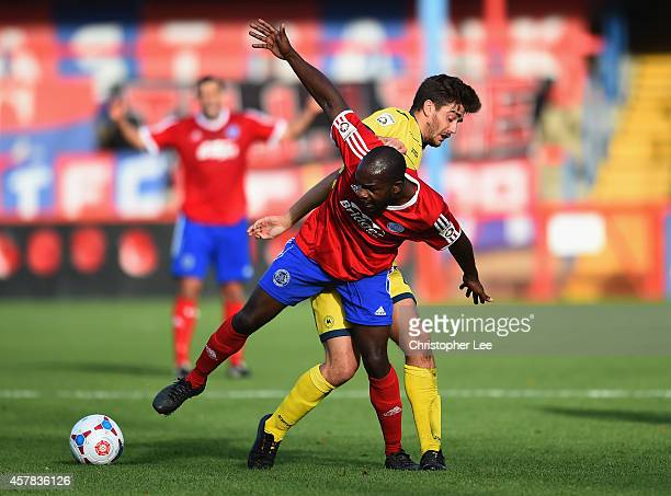 Kieron Forbes of Aldershot battles with Josh Wakefield of Torquay during the FA Cup Qualifying Fourth Round match bteween Aldershot Town and Torquay...