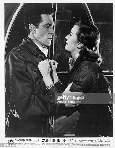Kieron Moore and Lois Maxwell having an intense moment in a scene from the film 'Satellite in the Sky', 1956.