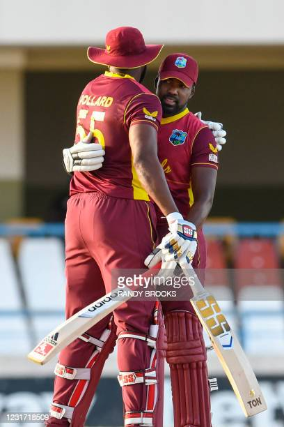 Kieron Pollard and Darren Bravo of West Indies celebrate a partnership during the 3rd and final ODI match between West Indies and Sri Lanka at Vivian...