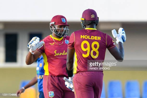 Kieron Pollard and Jason Holder of West Indies celebrate winning the 3rd and final ODI match between West Indies and Sri Lanka at Vivian Richards...