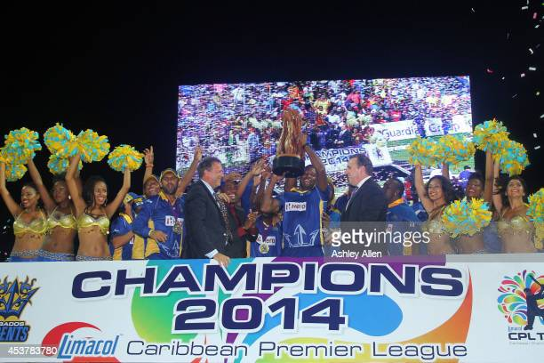 Kieron Pollard and the Barbados Tridents celebrate after the Limacol Caribbean Premier League 2014 final match between Guyana Amazon Warriors and...