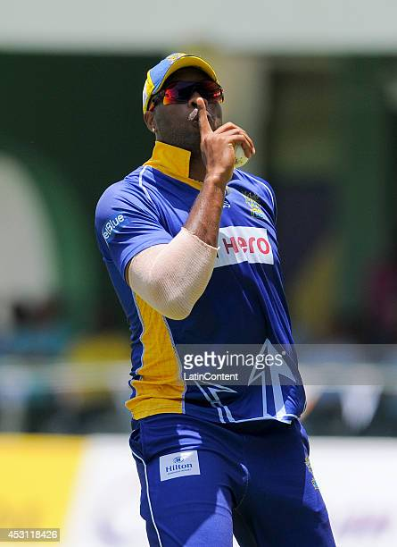 Kieron Pollard of Barbados Tridents celebrates taking the catch to dismiss Andre Russell of Jamaica Tallawahs during a match between Jamaica...