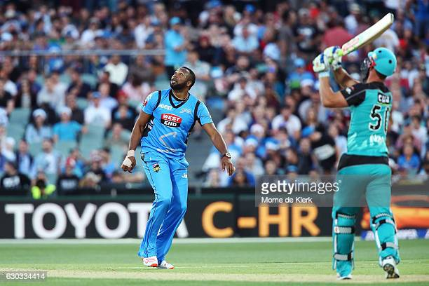 Kieron Pollard of the Adelaide Strikers looks on as Chris Lynn of the Brisbane Heat hits him for six during the Big Bash League match between the...