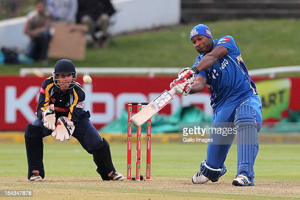 Kieron Pollard of the Mumbai Indians bats as wicketkeeper Dan Hodgson of Yorkshire looks on during the Karbonn Smart CLT20 match between Mumbai...
