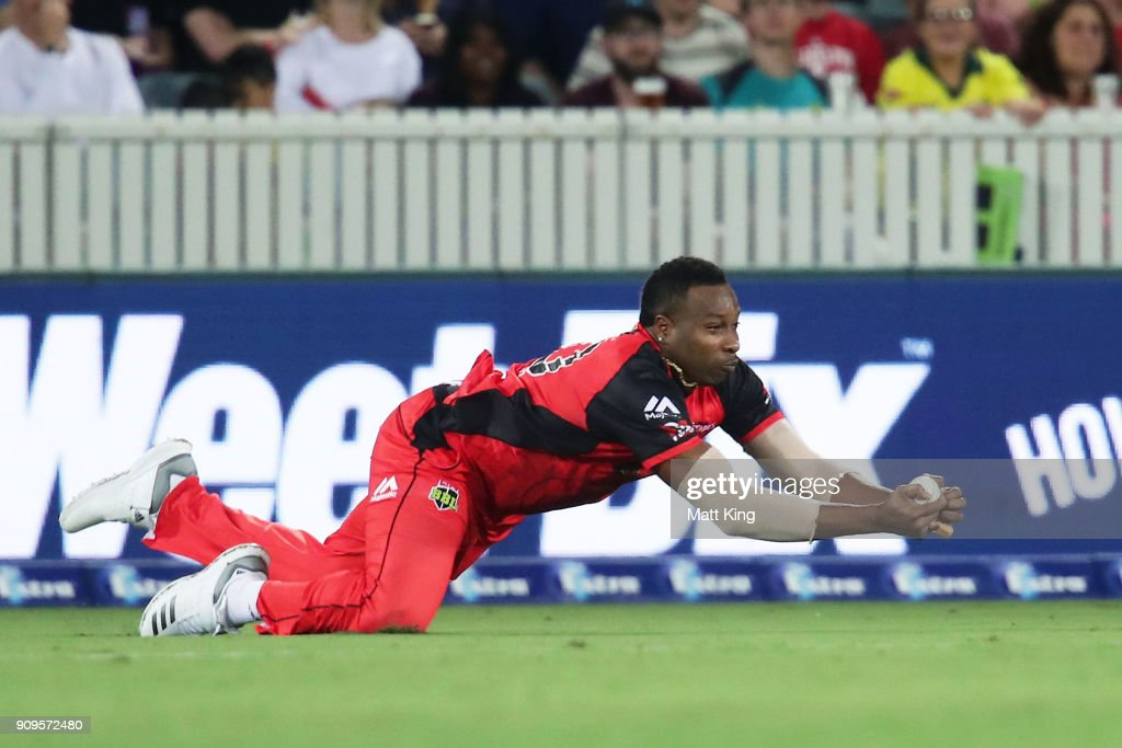 Kieron Pollard of the Renegades takes a catch to dismiss Shane Watson of the Thunder during the Big Bash League match between the Sydney Thunder and the Melbourne Renegades at Manuka Oval on January 24, 2018 in Canberra, Australia.