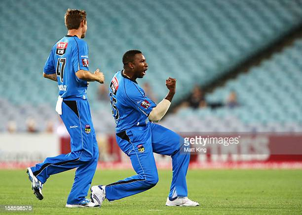 Kieron Pollard of the Strikers celebrates taking the wicket of Chris Gayle of the Thunder during the Big Bash League match between the Sydney Thunder...
