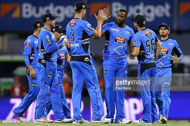 Kieron Pollard of the Strikers celebrates the wicket of Adam Voges of the Scorchers during the Big Bash League between the Perth Scorchers and...