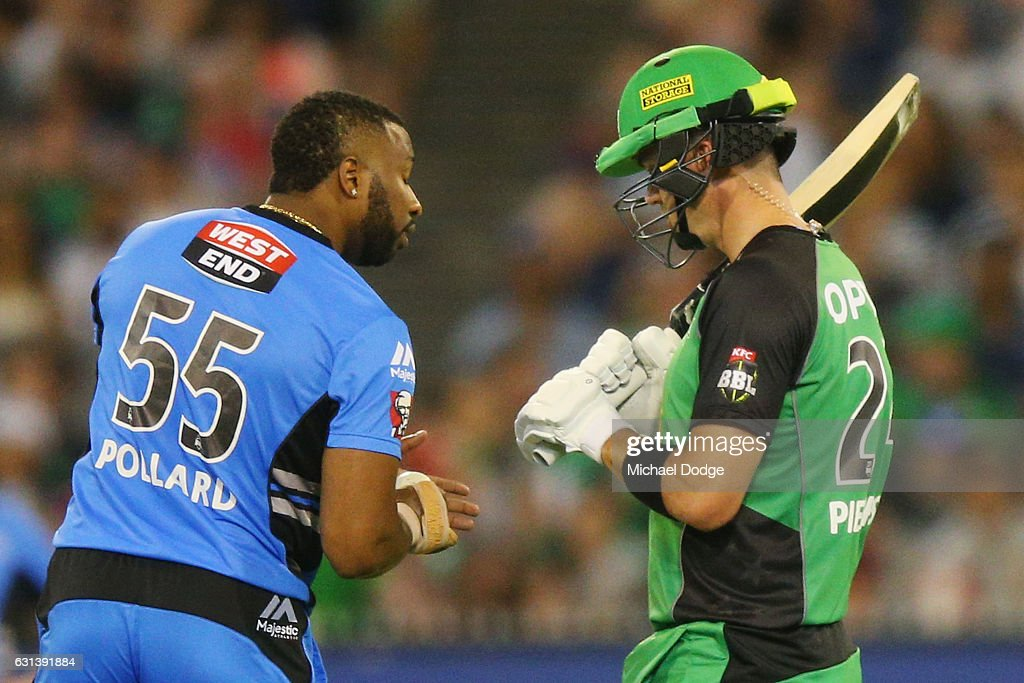 Kieron Pollard of the Strikers shows his hand to Kevin Pietersen of the Stars during his bowling over during the Big Bash League match between the Melbourne Stars and the Adelaide Strikers at Melbourne Cricket Ground on January 10, 2017 in Melbourne, Australia.