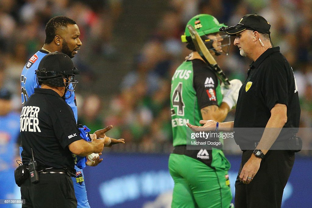 Kieron Pollard of the Strikers shows his hand to the umpires after talking with Kevin Pietersen of the Stars during his bowling over during the Big Bash League match between the Melbourne Stars and the Adelaide Strikers at Melbourne Cricket Ground on January 10, 2017 in Melbourne, Australia.