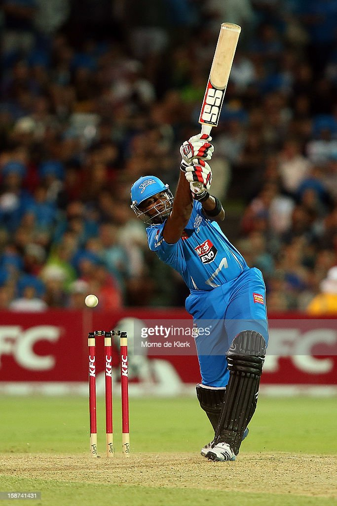 Kieron Pollard of the Strikers swings but misses a shot during the Big Bash League match between the Adelaide Strikers and the Melbourne Stars at Adelaide Oval on December 27, 2012 in Adelaide, Australia.