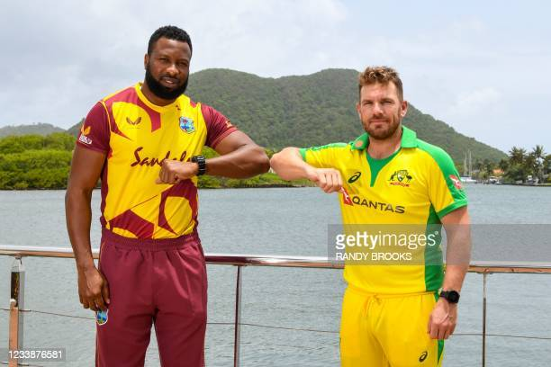 Kieron Pollard of West Indies and Aaron Finch of Australia pose for a photo one day ahead of the 1st T20 between Australia and West Indies at Darren...