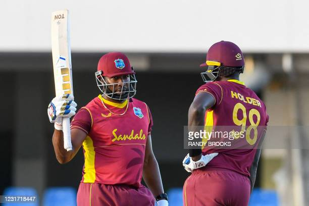 Kieron Pollard of West Indies celebrates his half century during the 3rd and final ODI match between West Indies and Sri Lanka at Vivian Richards...