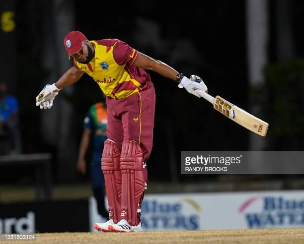 Kieron Pollard of West Indies celebrates hitting 6 sixes off Akila Dananjaya of Sri Lanka during a T20i match between Sri Lanka and West Indies at...