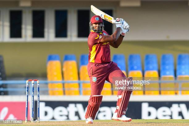 Kieron Pollard of West Indies hits 6 during the 3rd and final ODI match between West Indies and Sri Lanka at Vivian Richards Cricket Stadium in North...