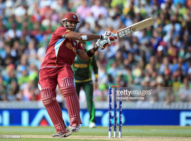 Kieron Pollard of West Indies hits the ball to the boundary during the ICC Champions Trophy group B match between West Indies and Pakistan at The...