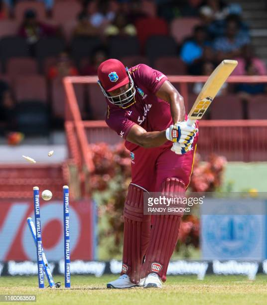 Kieron Pollard of West Indies is bowled by Navdeep Saini of India during the 3rd T20i match between West Indies and India at Guyana National Stadium...