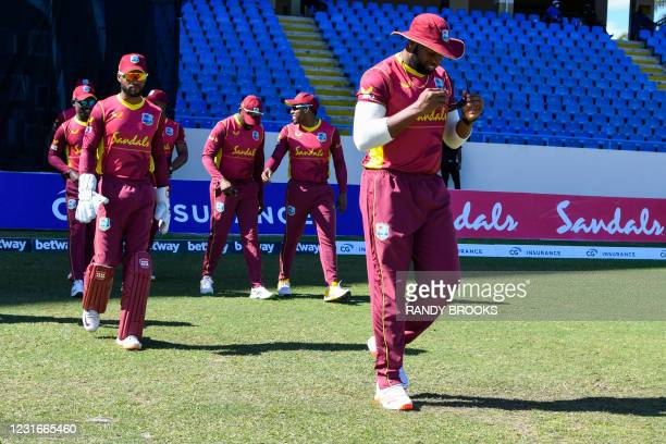 Kieron Pollard of West Indies leads his team onto the field at the start of the 2nd ODI match between West Indies and Sri Lanka at Vivian Richards...