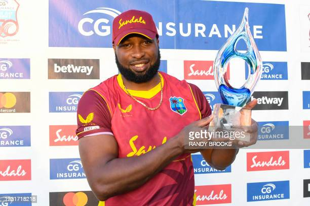 Kieron Pollard of West Indies poses with the series trophy after winning the 3rd and final ODI match between West Indies and Sri Lanka at Vivian...