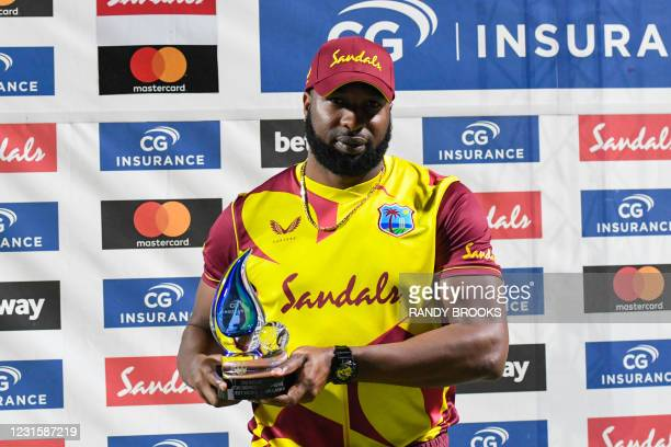 Kieron Pollard of West Indies poses with the trophy at the end of the 3rd and final T20i match between Sri Lanka and West Indies at Coolidge Cricket...