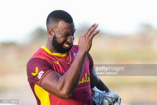 Kieron Pollard of West Indies signals taking the series 3-0 after winning on the 3rd and final ODI match between West Indies and Sri Lanka at Vivian...