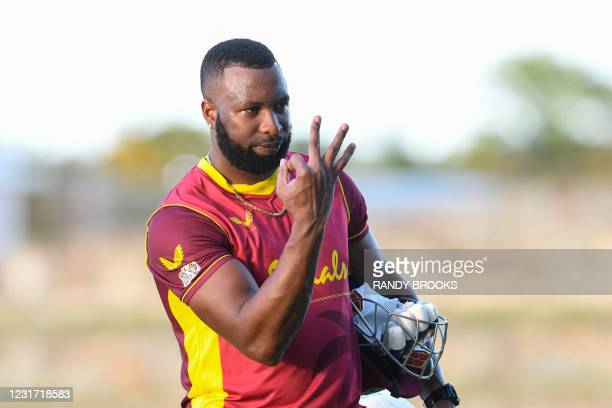Kieron Pollard of West Indies signals taking the series 3-0 after winning the 3rd and final ODI match between West Indies and Sri Lanka at Vivian...