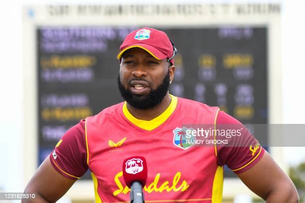 Kieron Pollard of West Indies speaks at the start of the 1st ODI match between West Indies and Sri Lanka at Vivian Richards Cricket Stadium in North...