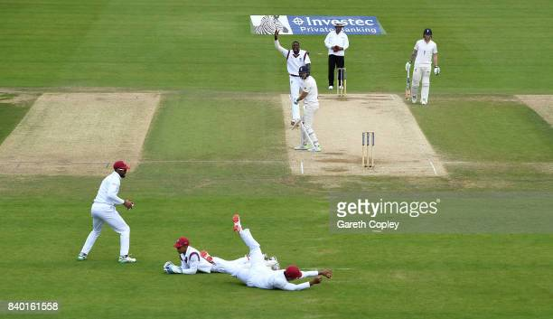 Kieron Powell of the West Indies lies on the ground after dropping Dawid Malan of England from the bowling for Jason Holder during day four of the...