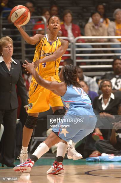 Kiesha Brown of the Los Angeles Sparks passes the ball over Ivory Latta of the Atlanta Dream on September 11, 2008 at Staples Center in Los Angeles,...