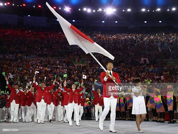 Kiesuke Ushiro of Japan carries the flag during the Opening Ceremony of the Rio 2016 Olympic Games at Maracana Stadium on August 5 2016 in Rio de...