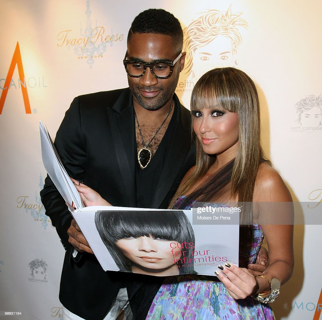 Kieth Cambell and Adrienne Bailon attends the 'Cuts Of Our Infirmities' book launch party at the Tracy Reese Boutique on April 22, 2010 in New York City.
