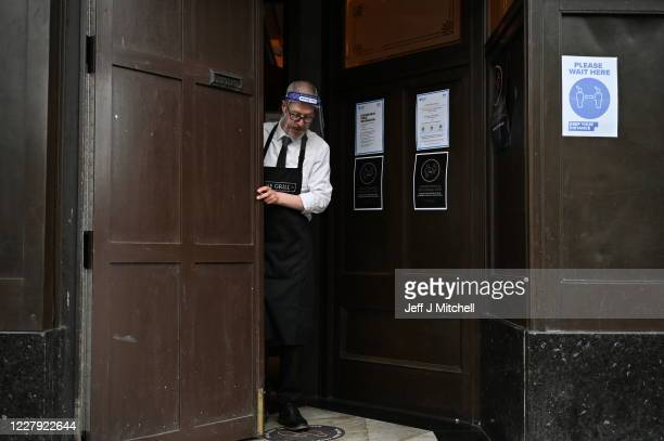 Kieth McKenzie wears a shielding face mask as he prepares to close the pub The Grill in Union Street at 5pm on August 5 2020 in Aberdeen Scotland...