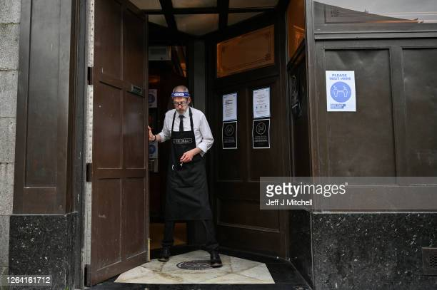 Kieth McKenzie wears a shielding face mask as he prepares to close the pub The Grill in Union Street at 5pm on August 5, 2020 in Aberdeen, Scotland....
