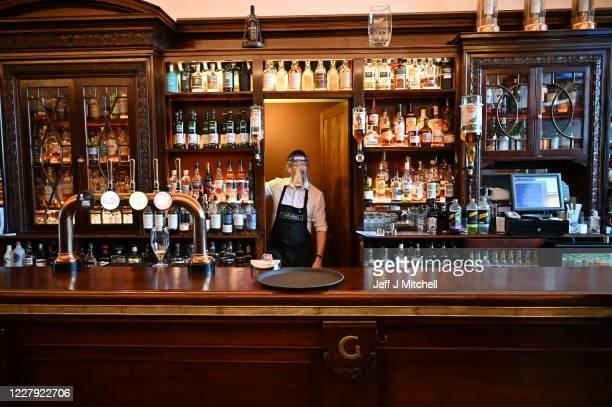 Kieth McKenzie wears a shielding face mask as he works in the pub The Grill in Union Street on August 5, 2020 in Aberdeen, Scotland. Scotland's First...