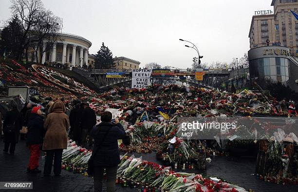 Kiev residents pile flowers to honor the dead in Maidan or Independence Square as they learn that their southern region of Crimea has been declared a...