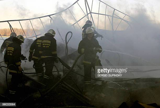 "Firemen extinguish a fire on a floating restaurant ""Poseidon"" moored to the quay on the Dnieper river in Kiev 30 October, 2005. According to..."
