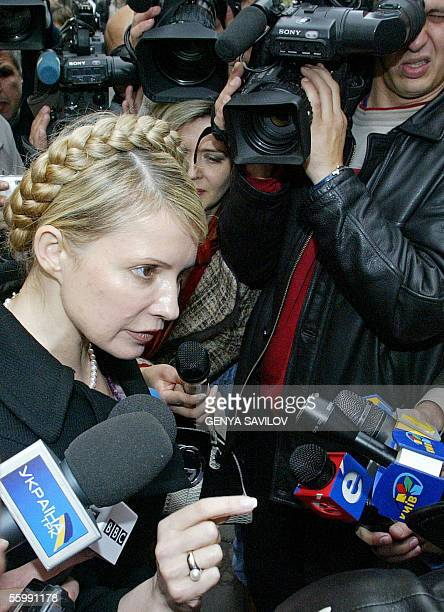 Former Prime Minister Yulia Tymoshenko speaks to reporters after a Krivorizhstal privatization auction in Kiev 24 October 2005 With a whopping...