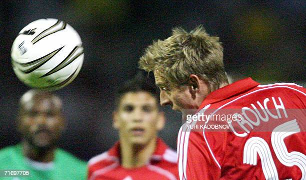 Liverpool's striker Peter Crouch heads the ball during the UEFA Champions League third qualifying round match against Maccabi Haifa in Kiev, 22...
