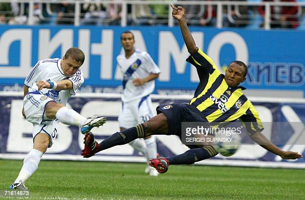 Sergiy Rebrov of Dynamo Kiev goes for a shot past Fenerbahce's Marko Aurelio during a Champions League qualifying round first leg match in Kiev 09...