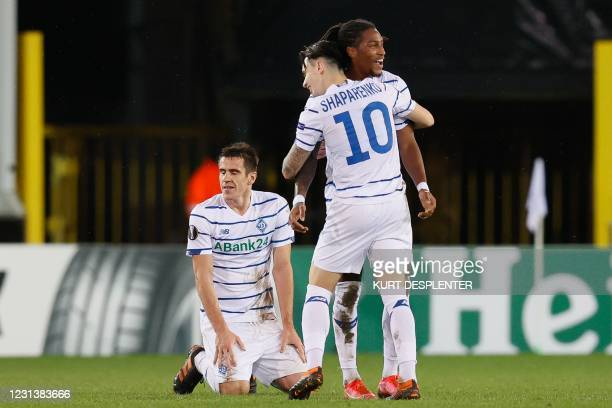 Kiev's Gerson Rodrigues and Kyiv's Mykola Shaparenko celebrate after scoring the 0-1 goal during the UEFA Europa League round of 32 second-leg...