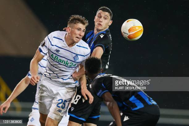 Kiev's llya Zabarnyi and Brugge's Federico Ricca vie for the ball during the UEFA Europa League round of 32 second-leg football match between Club...