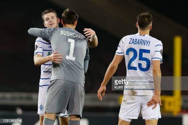 Kiev's players celebrate after winning the UEFA Europa League round of 32 second-leg football match between Club Brugge KV and FC Dynamo Kiev on...