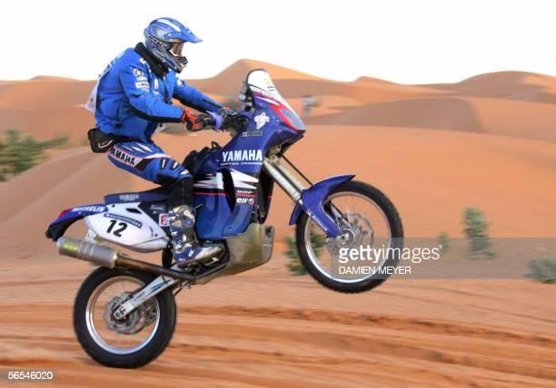 France's David Fretigne rides his Yamaha during the ninth stage of the 28th Dakar rally ran between Nouakchott and Kiffa, 09 January 2006. Spain's...