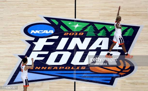 Kihei Clark and Mamadi Diakite of the Virginia Cavaliers react in the game against the Auburn Tigers during the 2019 NCAA Final Four semifinal at US...